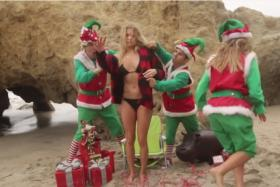 Country singer LeAnn Rimes hits the beach in a parka to announce her Christmas tour.