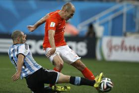 Javier Mascherano revealed that he tore his anus during the match-saving tackle against Holland's Arjen Robben.