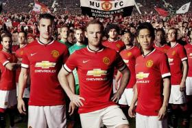 Man United players model their club's last home shirt from Nike for the 2014/15 season.