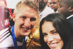 Adriana Lima with the injured Bastian Schweinsteiger at the World Cup 2014 final.