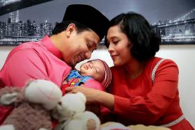 BLESSED: Radio DJ couple KC (left) and Fiza O with their firstborn Isa Awsam.