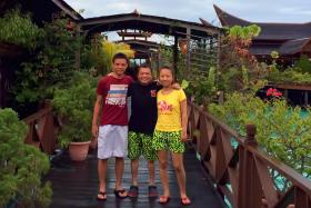 CLOSE CALL: Mr Loo Guan Xue (in white shorts), Mr Tong Hui Leong (in black) and Miss Liu Sha Sha (in yellow) at the resort.