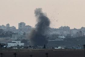 A picture taken from the southern Israeli city of Sderot shows smoke billowing from the Gaza Strip following an Israeli air strike.
