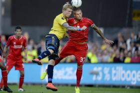 Simon Makienok of Brondby (L) vies with Martin Skrtel of Liverpool on July 16, 2014 at Broendby stadium suringa test match between Brondby and Liverpool. Broendby won 2-1.