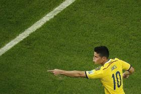 JAMES IN, ANGEL OUT? To finance the move for Colombia's World Cup sensation James Rodriguez (above), Real Madrid are likely to have to sell Angel di Maria.