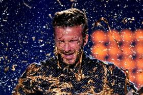 David Beckham in surprised with gold slime onstage during Nickelodeon Kids' Choice Sports Awards 2014 at UCLA's Pauley Pavilion on July 17 in Los Angeles, California.