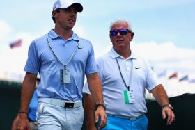 Rory McIlroy  (left) and his father Gerry were double winners on the weekend.  McIlroy won the British Open, while his dad won a bet he had placed in 2004 on his son to win the Open.