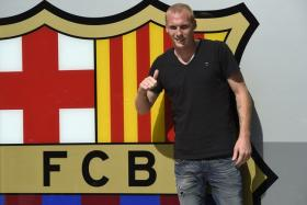 Barcelona's new French player Jeremy Mathieu poses outside the Nou Camp.