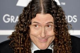 "File photo of US comedian-singer ""Weird Al"" Yankovic at the 54th Grammy Awards in Los Angeles, California on Feb 12, 2012. Yankovic has scored a career-first No. 1 album following a viral video campaign parodying the biggest hits of the past year."