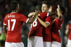 Man United new boy Ander Herrera (second from right) celebrates with goalscorer Ashley Young during the Red Devils' 7-0 thrashing of the LA Galaxy.