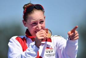 England triathlete Jodie Stimpson claimed the first gold medal of the 2014 Commonwealth Games held in Glasgow, Scotland.