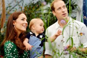 Prince William and his wife Catherine and son George at the Sensational Butterflies exhibition at the Natural History Museum in London on July 2.