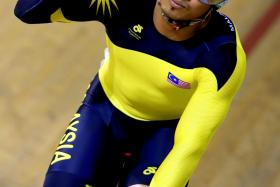Malaysia's Mohd Azizulhasni Awang, wearing gloves that read Save Gaza, celebrating his win against England's Philip Hindes during the men's sprint first round in the Sir Chris Hoy Velodrome during the Commonwealth Games in Glasgow on July 24.