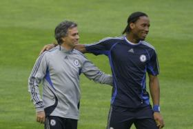 Didier Drogba and Jose Mourinho have a light moment during a Cheslea training session from 2007.