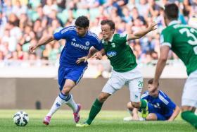 Chelsea's Diego Costa vies for the ball with Olimpija Ljubljana's Antonio Delamea Mlinar.