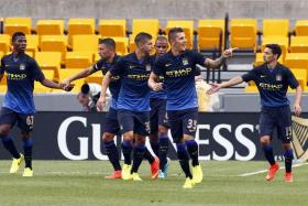 Stevan Jovetic (No. 35) celebrates after scoring Manchester City's first goal against AC Milan in the International Champions Cup.