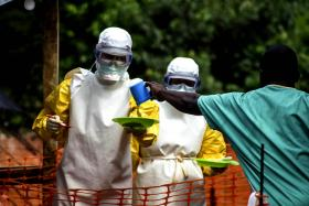 Food being prepared for patients kept in an isolation area at the Medecins sans Frontieres Ebola treatment centre in Kailahun, Sierra Leone, on July 20.
