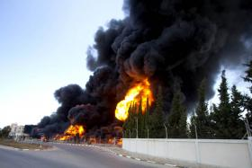 Flames engulfing the fuel tanks of the only power plant supplying electricity to the Gaza Strip. The plant was hit by shelling on Tuesday.