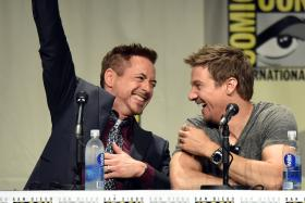 Actors Robert Downey Jr. (L) and Jeremy Renner attend the Marvel Studios panel during Comic-Con International 2014 at San Diego Convention Center on July 26, 2014.