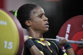 A picture dated July 25, 2014, shows Nigeria's gold medalist Chika Amalaha competing in the women's weightlifting 53kg class.