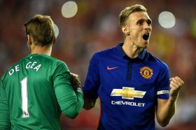 Darren Fletcher celebrates with David de Gea after scoring the winning penalty for Manchester United during their friendly match with Inter Milan in Maryland.
