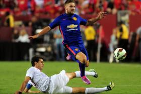 Manchester United left-back Luke Shaw in action against Inter Milan during a friendly match, says he underestimated the increased fitness demands when he made the step up from Southampton.