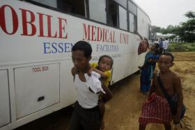 Indian villagers affected by malaria board a mobile medical unit to be taken to a primary health centre in Dalapati village, some 170 kms north of Agartala, the capital of the north-eastern state of Tripura.