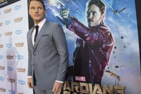 "Chris Pratt poses at the premiere of ""Guardians of the Galaxy"" in Hollywood, California."