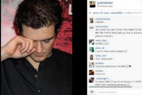 Justin Bieber posted a photo of Orlando Bloom crying following their fight at an Ibiza restaurant.