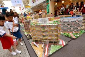 Hundreds of kindergarten students have recreated 48 of Singapore's public housing estates from 1960s to the present, using recycled Yeo's packaging and other recycled materials.