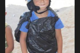 """Young boy in Gaza approaches Swedish correspondent and says: """"I am a journalist...I am reporting on what is happening here, this is my flak jacket."""" His flak jacket was made from a garbage bag."""