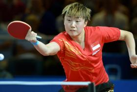 File photo of Feng Tianwei in action at the Commonwealth Games in Glasgow.