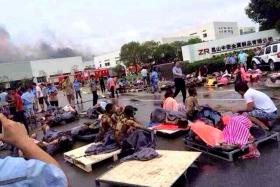 Rescuers helping the victims of an explosion at a factory in Kunshan, Jiangsu province on Saturday.