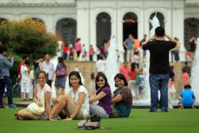 Members of the public taking photos at the Istana.