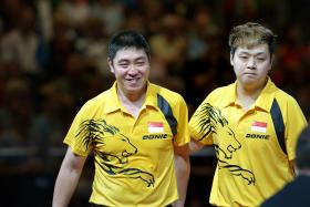 Singapore men's doubles pair of Gao Ning (left) and Li Hu beat the Indian pair to win the men's doubles gold.