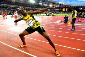 Jamaica's Usain Bolt posing after winning the men's 4 x 100m relay athletics event at Hampden Park during the 2014 Commonwealth Games in Glasgow, Scotland on Saturday.