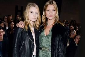 Model Kate Moss (right) and her younger sister Lottie at the launch of the Topshop Unique line at London Fashion Week.