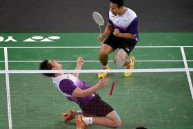 JUBILATION: Singapore's Chayut Triyachart (left) and Danny Chrisnanta (top) screaming in delight after clinching the ticket to the men's doubles final.