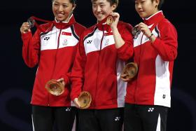 MAJULAH: The Singapore table tennis team had a fruitful day yesterday. Gao Ning and Li Hu won the men's doubles crown while Zhan Jian and Yang Zi claimed the bronze. In the women's singles, Feng Tianwei (centre, far left) led a podium sweep with Yu Mengyu and Lin Ye.