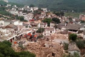 A general view shows collapsed houses after an earthquake hit Ludian county.