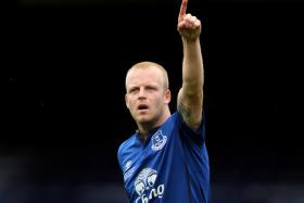 Everton striker Steven Naismith bought tickets for his club's matches to be distributed to the jobless on Merseyside.
