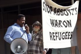 A man addressing the crowd at a rally last month protesting the Australian government's treatment of Sri Lankam asylum-seekers in Sydney.