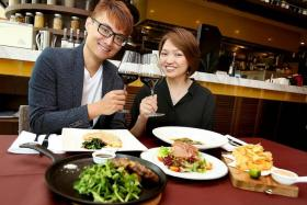 TOAST TO FOOD & FRIENDS: UFM 100.3 radio DJs Vincent Lim and Carine Ang enjoying lunch at Japanese-Italian restaurant Arossa Wine & Grill in Scotts Square.