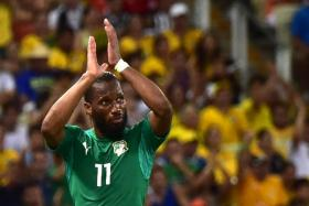Didier Drogba celebrates after an Ivory Coast goal at the 2014 World Cup.