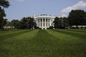 A toddler squeezed through the White House gates on Thursday evening, causing a brief security lockdown.