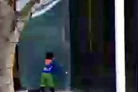 MISHAP: CCTV footage showing the boy swinging the door till it hit the frame and got dislodged.