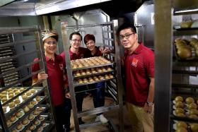 FAMILY AFFAIR: (Above, from left) Ms Nelly Tay, Mr Johnson Tay, Ms Evan Tay and Mr Ken Tay of SMH Food.