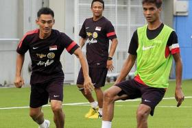 Time to deliver: Fandi Ahmad (centre) and his assistant Nazri Nasri (far left) want the LionsXII to prove themselves in the Malaysia Cup after their disappointing eighth-placed finish in the MSL.