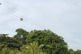 Cable car falls at Sentosa construction site. No one injured. More photos to come.