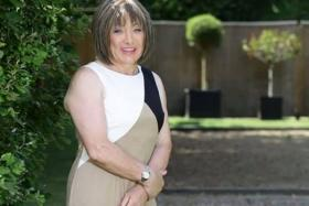 Kellie Maloney, posing for pictures, use to be known as the legendary boxing promoter Frank Maloney.